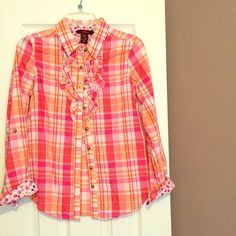 Colorful plaid button down sz M with floral accent Adorable button down size M, but fits more like a small. Cuffs have adorable floral accents or the sleeves can be rolled up as shown in the last picture. Ruffle detailing by the top 4 buttons. In great condition- never worn. 1955 Vintage  Tops Button Down Shirts