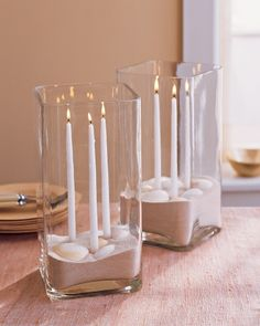 Sand-and-Shell Centerpiece    For a beach weddding, bring a bit of the shore to your tables with this sandy centerpeices. To recreate, use candle adhesive to secure slender tapers to the bottom of a clear glass vase. Carefully pour in a few inches of sand, then arrange shells on top. Besides refracting the candlelight for added ambience, the vase will protect the flames from breeze.