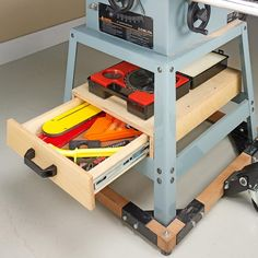 DL GREAT - under-saw storage. use for band saw, table saw, drill press, and multi-table by Gloria Garcia Workshop Storage, Workshop Organization, Garage Workshop, Tool Storage, Storage Spaces, Workbench Organization, Workshop Ideas, Woodworking Crafts, Woodworking Projects