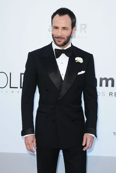 Does it get any more dashing than this designer and filmmaker in a tuxedo of his own design?