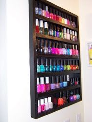nail polish rack -i need one of these.. .in my office. ..on my wall.