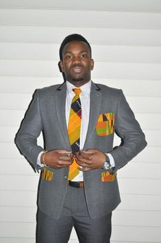 "One word, ""Dapper""! Check out our Kente ties and bow ties to finish up the look. The Kente cloth pockets add the African flair to an elegant GQ slim fit blazer."