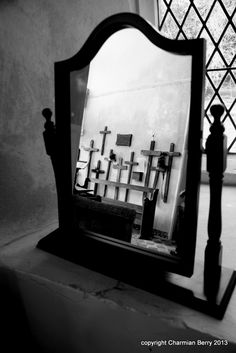 Mirror to the past...... by Charmian S Berry - The Crosses on  the walls of Melton Old Church were brought back from the battlefields of France and were replaced with permanent headstones. This Church is now a redundant Church but we have a com...