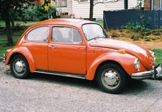 a 1970s era VW Type I Super Beetle, with the 1.5L 54hp flat four cylinder engine, and a 4-speed transmission. It looks fantastic in orange.