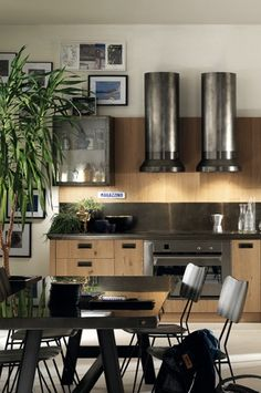 TWO of these vent hoods mean you can use a slightly lower rated model. -  Diesel Social Kitchen for Scavolini.