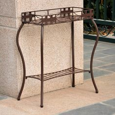 Use this rectangular outdoor plant stand to hold your plants inside or outside the home. This plant stand is constructed from steel and has been finished to brave the elements and can be placed in the garden to give the area a touch of class.