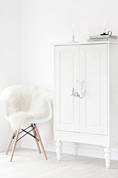 Blog — Mae Gabriel  White Interiors. Eames Chair. White Sheepskin Rug. Serax Belgium Candle Holder.