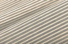 This contemporary silver striped fabric adds a fun transitional element to interior designs. Pair with a pop of orange for a modern look.