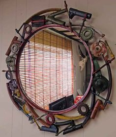 Mirror with frame hand crafted from salvaged / up cycled bicycle wheel rims and parts.  From Impact Imports of #Boise and #Philadelphia.