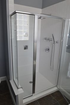 White subway acrylic, looks like tile but comes with a lifetime warranty. Super easy to clean.