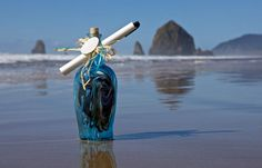 Message in a Bottle at Cannon Beach Oregon. Haystack Rock in background.