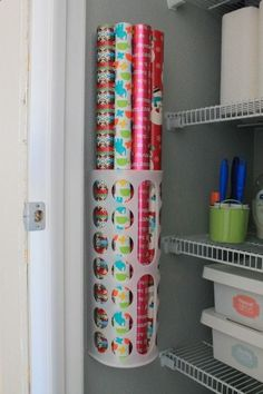 Our fancy wrapping paper storage is a $1.50 plastic bag holder from IKEA.