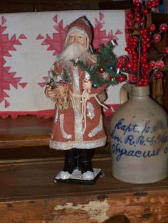 Prim Father Christmas, stoneware jug, antique quilt...yes!