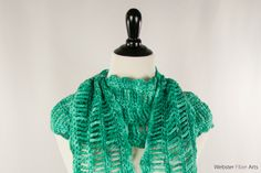 Hi folks, I am really proud of this scarf. This is Strumming Teal: