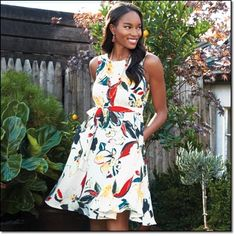 """Romantic Floral Dress Feminine fit-and-flare silhouette in a boldly floral print. Elastic waist and tie belt. Polyester. Machine wash, line dry. Imported. Sizes: S(6-8), M(10-12), L(14-16), XL(18 Center back length, 39 1/4"""" (on Medium). Brochure: $34.99"""