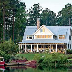 Welcome to the 2014 Palmetto Bluff Idea House in Bluffton, South Carolina! | Surrounded by pine trees and nestled beside a lake, the east-facing back porch offers unrivaled views of the sunrise.
