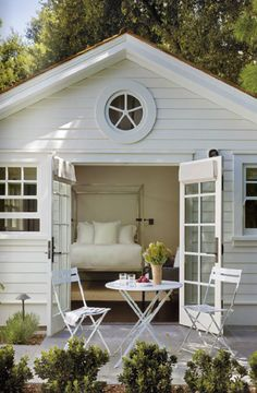 A Classic House NORTHERN CALIFORNIAN GUEST COTTAGE NICKLE COATED BED WITH WHITE LINEN AND SEATING