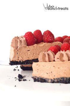 No Bake Raspberry Chocolate Cheesecake ~ Delicious, Easy Chocolate Cheesecake with a Delicious Oreo Crust, Creamy Chocolate Cheesecake and Topped with Fresh Raspberries and Chocolate Whipped Cream!