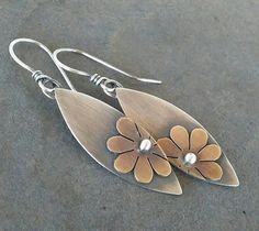 This pretty pair of flower earrings is handmade by me using sterling silver and brass. They measure 2 inches in length from the top of the ear wire to the bottom of flower dangle. They have been oxidized to show detail and rustic charm. Mixed Metal Jewelry, Metal Clay Jewelry, Copper Jewelry, Gold Jewellery, Handmade Sterling Silver, Sterling Silver Jewelry, Silver Ring, Marcasite Jewelry, Soldering Jewelry