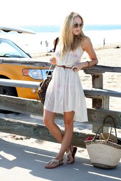 (bag Rebecca Minkoff, dress H, sunglasses Gucci, shoes Urban Outfitters, bathing suit Vix)