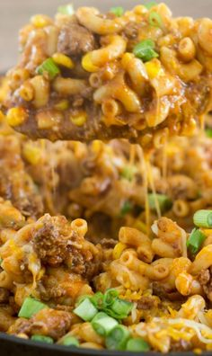 One Skillet Cheesy Taco Pasta Recipe ~ A pasta dish with extra lean ground beef, taco seasoning, taco sauce, corn, and plenty of cheese that comes together all in one skillet – even the pasta gets cooked in the same skillet!