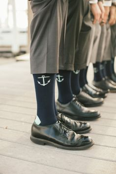 Add a subtle nautical element to the groomsmen's attire. Socks with anchors add a great on-theme touch.