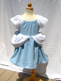 Cinderella beach cover up for little girls!!  Not sure they'd want to get into the water with a cover up like this! Would be great after a bath too.