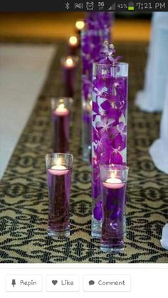 i like the purple orchids in water (not sure if they fit with venue.. mayb white orchids)