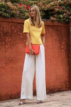calm: yellow shirt with a signal red bag and white wide-leg pants