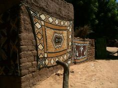 Africa | Mud cloth for sale displayed on walls, Dogon country, Mali.  The cloth is made from cotton grown in Mali which is then laboriously spun and woven into strips.  These are then sewn together and dyed into wonderful patterns.  | © A city Girl in Africa.