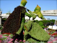 Aurora & Prince topiary, Epcot... this would only be made better if Aurora's dress has pink and blue lights inside that periodically changed colors.