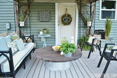 Such a pretty patio! Clever how they made the little table! (Spool top and a metal tub!)