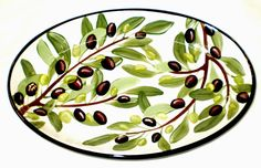 Small olive oval platter, a current pattern painted by Geoff Graham in Vallejo, California at Cinnabar Ceramics.  You can google the Cinnabar Ceramics Website if you want to know more.