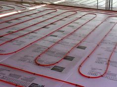Hydronic radiant floor heating systems use solar energy collected from a homes pre-existing solar panels to heat water and send it through tubes laid beneath the floor. This hydronic system, used in conjunction with a solar water heater by SunEarth, is compatible with any type of floor. #tinyhome #containerhome