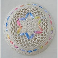 Harness the sweet energy of springtime felicity with this cheerfully charming off white kippah, laced with pastel ribbons seemingly just snatched from the maypole. Kippah measures 17cm. Priced at $7.95 at www.judaicaspecialties.com