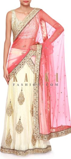 Buy Online from the link below. We ship worldwide (Free Shipping over US$100). Product SKU - 308866.Product Link - http://www.kalkifashion.com/coral-and-cream-lehenga-saree-adorn-in-mirror-and-kardana-embroidery-only-on-kalki.html