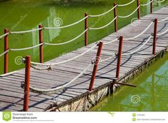 boardwalk walkway | Close up of a floating walkway on a lake with poles and rope handrails ...