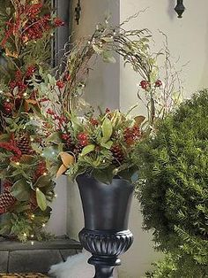 Set a festive scene in your outdoor space this holiday season with the Cordless Winter Garden Urn Filler; featuring an abundant mixture of lifelike elements such as magnolia leaves, pinecones and berries.