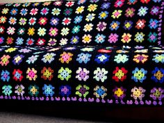 Made to order please allow 2-3 weeks for dispatch or please message me with timescale requirements. This is the must have Betty granny square blanket. The blanket is constructed from 15 rows of 15 squares across - so 225 in total and is bordered with traditional black. The finished