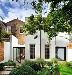 Kensington Residence is situated with a Royal Borough conservation area in London, designed by Studio Seilern Architects. This project rebuilds and combines two twin Victorian terrace houses behind historic facades to create one large family dwelling. The goal was to present a modern interpretation of a traditional Kensington abode.