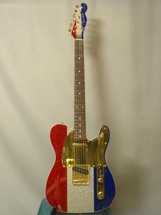 Buck Owens Red-White and Blue Telecaster with gold pick guard and hardware. Cheap Electric Guitar, Beginner Electric Guitar, Fender Electric Guitar, Telecaster Guitar, Cool Electric Guitars, Guitar Shop, Cool Guitar, Blue Guitar, Gibson Guitars