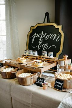 DIY Popcorn Bar - As the weather starts to cool, stay indoors and host a Girls Night In with drinks and a popcorn bar! Credit: The Perfect Palette