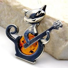 'Playful Cat' Sterling Silver Natural Baltic Amber Pendant  Price : $37.50 http://www.silverplazajewelry.com/Playful-Sterling-Silver-Natural-Pendant/dp/B00IVO84NC