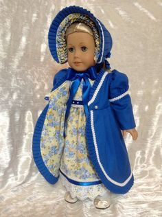 This listing is RESERVED for Diane. Here is a new ensemble for your Caroline or any other American Girl doll. The dress is made using a premium yellow and blue floral print cotton. This dress has an empire waist like in the early 1800s. It has a rounded neckline and puffed sleeves with sleeve bands. Both the neckline and sleeves are trimmed in a dainty lace. The bodice is fully lined. The bottom of the skirt has venice lace and blue satin ribbon. The waistband is a double faced satin…