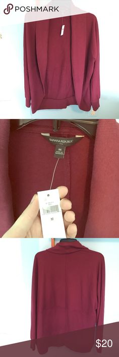 """Brand new burgundy/maroon cardigan This Banana Republic cardigan still has the tags and it has never been worn before. It's brand new. (The only reason the price is ripped off the tag is because it was a gift). The """"collar"""" folds over and flows down nicely into a scooped bottom. Pretty thick material so it can be worn both for warmth and style💁🏼. It's a medium but I think it could also fit a large Banana Republic Sweaters Cardigans"""