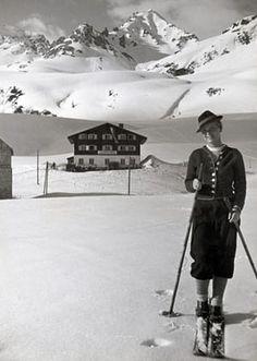 vintage ski 1935: Female skier in traditional dress at the Arlberg, Austria.