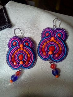 Earrings I made using soutache and bead embroidery techniques.