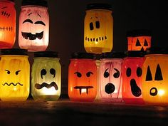 Painted ghoulish luminaries - I am loving jar crafts! Must go to goodwill and clean out their glass department!