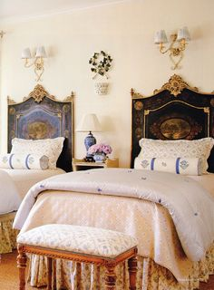 Elegant twin beds with mix of prints