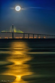 'The Moon  the Bridge' - photo by Lynn Wiezycki, via 500px;  moonrise over the Skyway Bridge, Tampa, Florida
